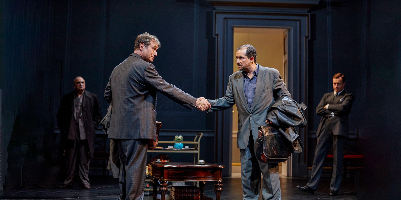 Still from Oslo – Paul Herzberg shaking a man's hand
